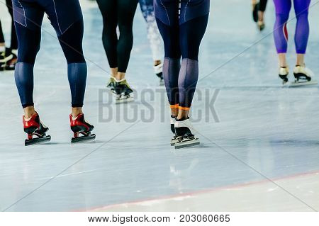 feet athletes speed skaters in competitive of ice skating