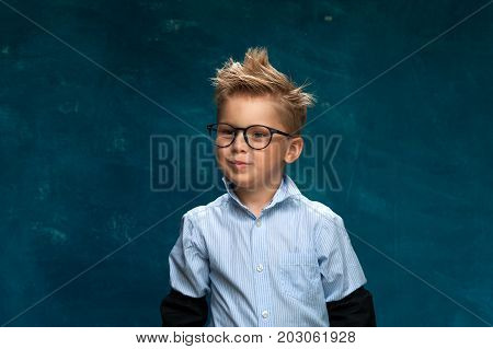 Funny portrait of caucasian child wearing eyeglasses and shirt imitating businessperson or office worker.