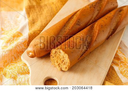 French White Long Baguette Bread On A Table