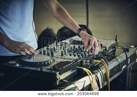 DJ's hands and turntable closeup. selective focus