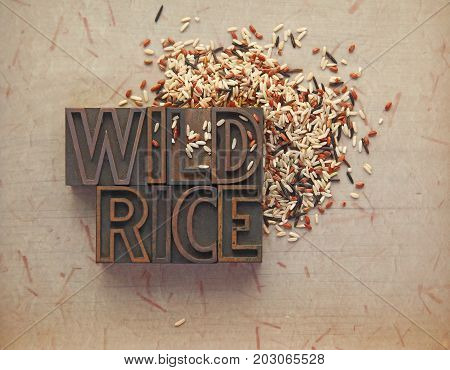 Wild rice with wood type words on textured background with room for text