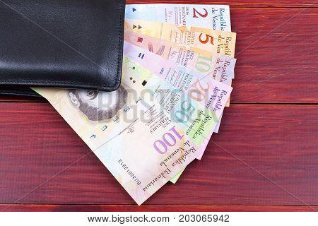 Venezuelan money in the black wallet - Bolivares