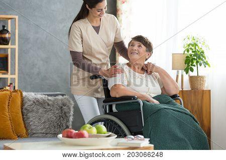 Young Intern Visiting Elder Patient