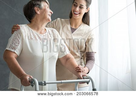 Woman And Volunteer Laughing Together