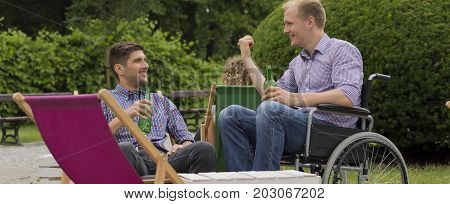 Talk between man and his disabled friend