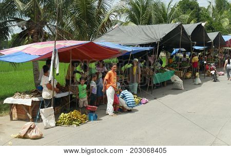 DAVAO ORIENTAL, PHILIPPINES--Famers and growers sell their produce from their makeshift tents at the street market in Banaybanay, Davao Oriental in March 2016.