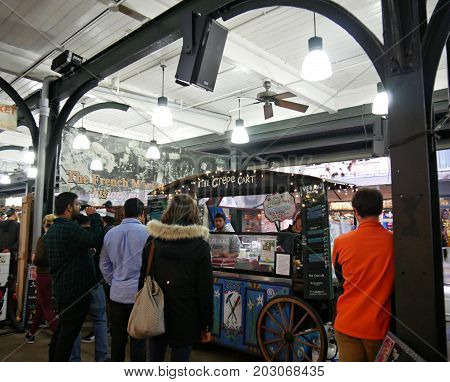NEW ORLEANS, LOUISIANA--Customers flock to a crepe food cart at the French Market in New Orleans, Louisiana in January 2017.