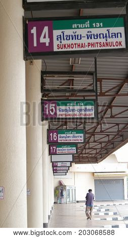 SUKHOTHAI CITY, THAILAND--Sukhothai City Bus Terminal with all the sign boards for the different destinations, photo taken early one morning in March 2016.
