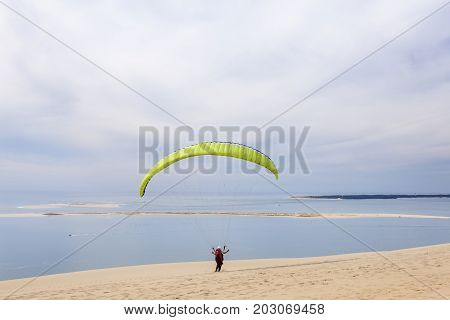 Paraglider at the Dune of Pilat - the tallest sand dune in Europe. The dune is located in La Teste-de-Buch in the Arcachon Bay area France