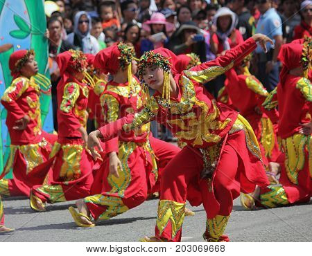 DAVAO CITY, PHILIPPINES--AUGUST 2014: Streetdancers vie for top prizes at the Kadayawan parade. Kadayawan is celebrated August each year to give thanks for life and an abundant harvest.