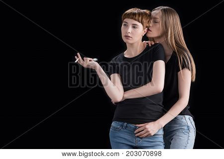 Young Woman Embracing Girlfriend