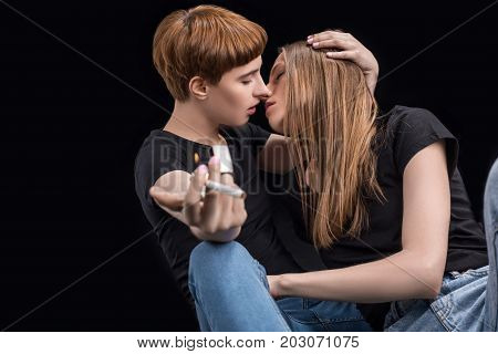 Young Woman Kissing Girlfriend