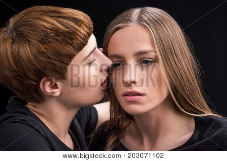 Woman Kissing Girlfriend On Cheek