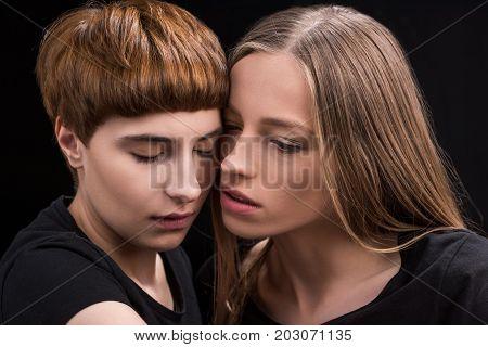 Lesbian Couple Touching Cheeks