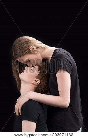 Woman Kissing Forehead Of Girlfriend