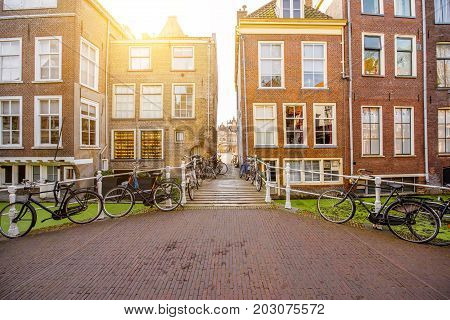 View on the beautiful old buildings and water channel in Delft town during the morning light, Netherlands