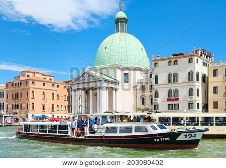 VENICE,ITALY - JULY 25,2017 : A vaporetto, the public waterbus, sailing on the Grand Canal in Venice