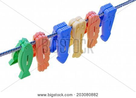 Colorful clothes pegs on a rope isolated on white background background