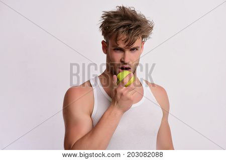 Athlete With Messy Hair Bites Fresh Fruit. Nutrition And Health