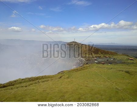 From the top of the hill, Masaya volcan smoking its sulfur gas from its crater. Masaya, Nicaragua