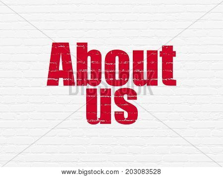Marketing concept: Painted red text About Us on White Brick wall background