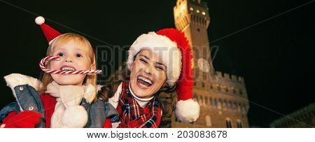 Mother And Child Tourists With Christmas Candy Cane In Florence