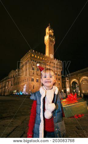 Girl With Christmas Present Box Near Palazzo Vecchio, Florence