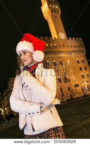 Pensive Woman In Christmas Hat In Florence Looking Into Distance