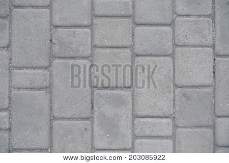Dusty Grey Pavement Made Of Concrete Blocks