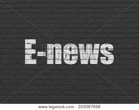 News concept: Painted white text E-news on Black Brick wall background