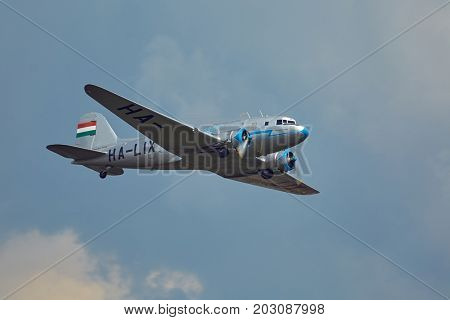 BUDAPEST, HUNGARY - MAY 1, 2014: Li-2 aircraft flying over Budapest. This aircraft is 65 years old, Soviet version of the legendary DC-3