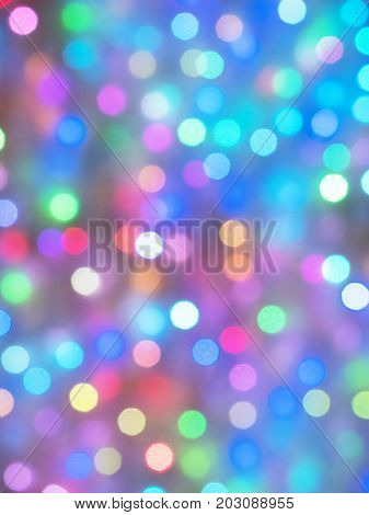 Holiday city lights bokeh or blur abstract. Color full of  focus holiday lights. Soft focus.