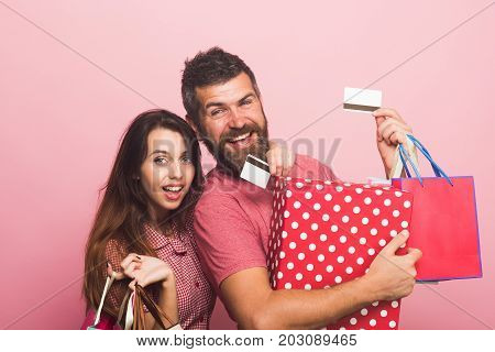Couple In Love Hugs Holding Big Box And Shopping Bags