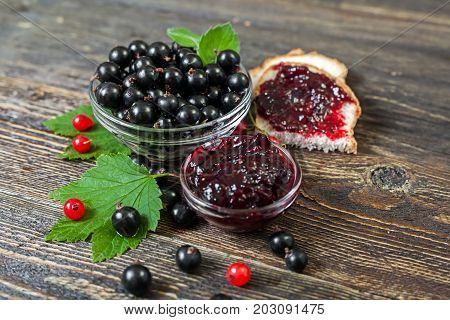 Black currant - large ripe berries. Sandwich with black currant jam.