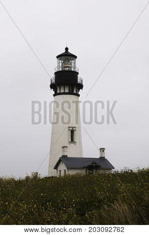 Yaquina Head Lighthouse against the cloudy Oregon sky in Newport Oregon