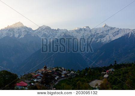 Kalpa village and Kinnaur Kailash sacred peak at sunrise view. Himachal Pradesh, India.