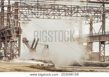 Heavy industry plant shop. Hot slag dump in metallurgical industry.