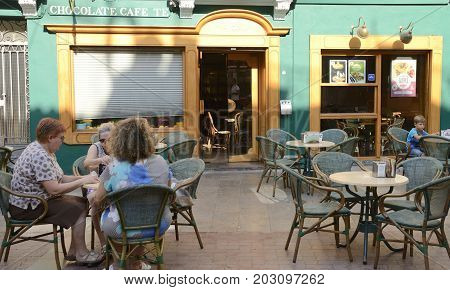 CASTELLON, SPAIN - JULY 22, 2017: People sitting at outdoors of a coffee shop in a central place of Castellon Valencian Community Spain.
