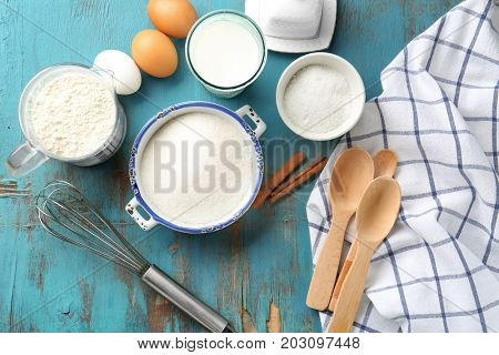 Composition with some products for cooking vanilla cake on wooden background