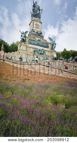 Hesse Germany - July 16 2017: The Niederwalddenkmal monument located in the Niederwald landscape park near Rüdesheim am Rhein in Hesse Germany. It overlooks the valley of the Rhine and was built in the 1870/80s to commemorate the Unification of Germany.