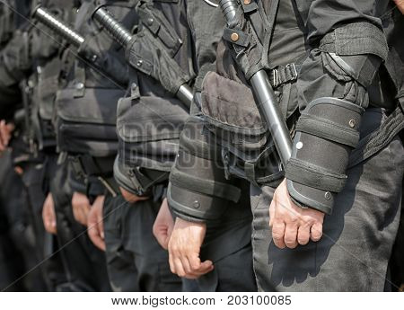 National police standing outdoors