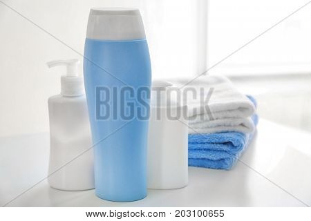Composition with bath cosmetics and towels on table