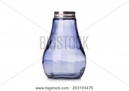 A dark blue glass salt and pepper shakers, colorful salt and pepper pots, small containers for salt and pepper isolated on a white background.