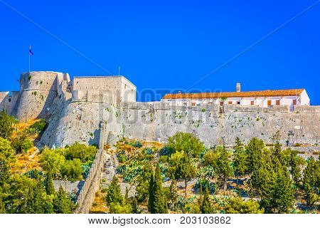 Scenic view at old historic fort in town Hvar, famous travel sightseeing spot in Croatia, Mediterranean.