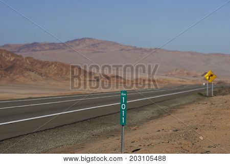 Pan American Highway (Ruta 5) running through the harsh and arid landscape of the Atacama in northern Chile.