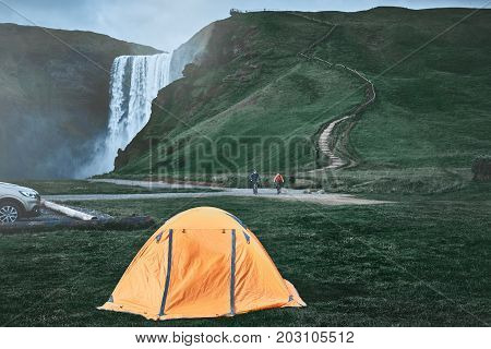 camping near famous Skogafoss waterfall in southern Iceland. treking in Iceland. Travel and landscape photography concept poster