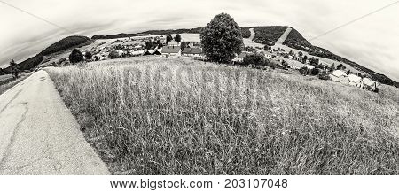 Panoramic photo of Cicmany village Slovak republic. Folklore theme. Rural landscape. Travel destination. Black and white photo.
