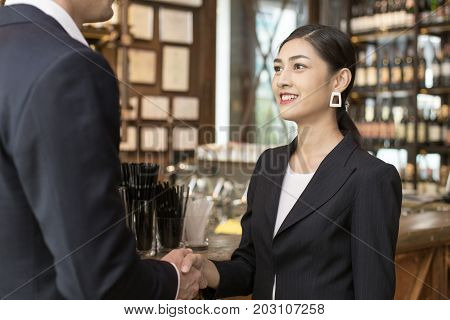 Woman With Agreement For Working With Businessman At Bar. Business Handshake And Business People Con