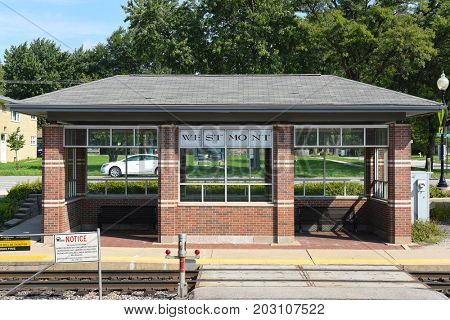WESTMONT, ILLINOIS - SEPTEMBER 5, 2016: Westmont train platform. The station on Metra's BNSF Railway Line in Westmont, Illinois, is 19.4 miles from Union Station.