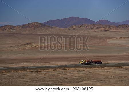 Atacama Desert, Chile - August 18, 2017: Tanker carrying acid for the mining industry on the Pan American Highway running through the harsh and arid landscape of the Atacama in northern Chile.